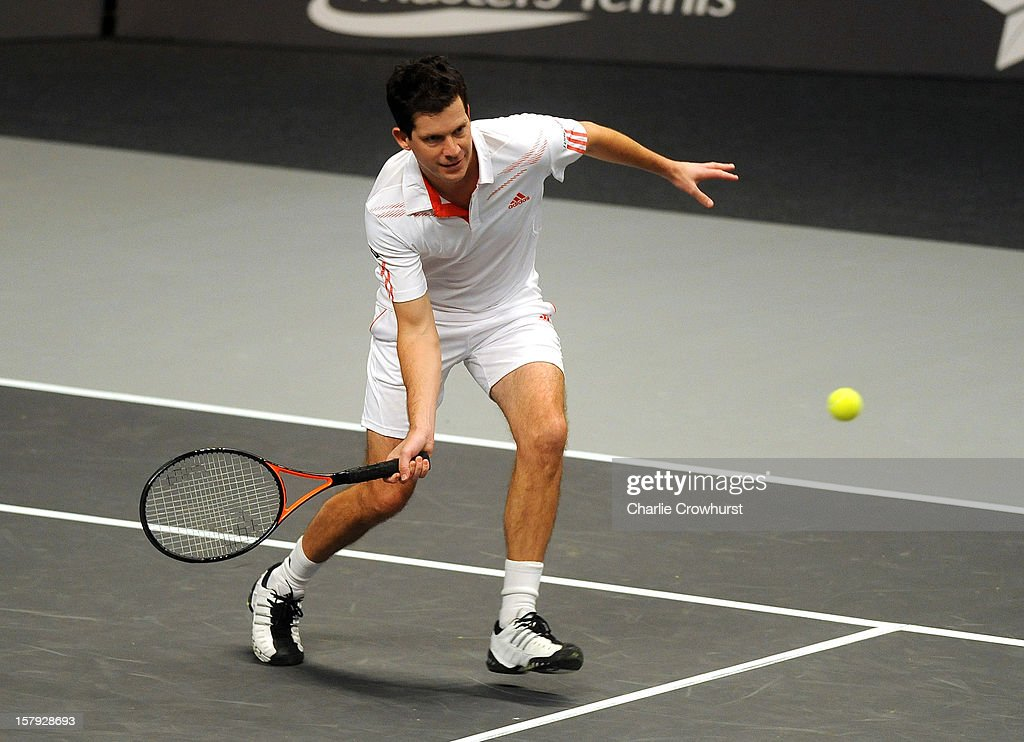 Doubles pair Tim Henman of England and Thomas Enqvist (not pictured) of Sweden in action during the match against Carlos Moya of Spain and Fabrise Santoro of France on Day Three of the Statoil Masters Tennis at the Royal Albert Hall on December 7, 2012 in London, England.