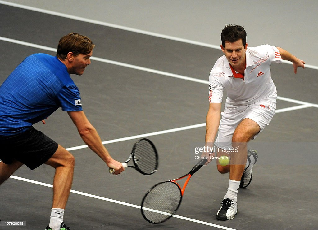Doubles pair <a gi-track='captionPersonalityLinkClicked' href=/galleries/search?phrase=Tim+Henman&family=editorial&specificpeople=167277 ng-click='$event.stopPropagation()'>Tim Henman</a> (R) of England and <a gi-track='captionPersonalityLinkClicked' href=/galleries/search?phrase=Thomas+Enqvist&family=editorial&specificpeople=162773 ng-click='$event.stopPropagation()'>Thomas Enqvist</a> of Sweden in action during the match against Carlos Moya of Spain and Fabrise Santoro of France on Day Three of the Statoil Masters Tennis at the Royal Albert Hall on December 7, 2012 in London, England.