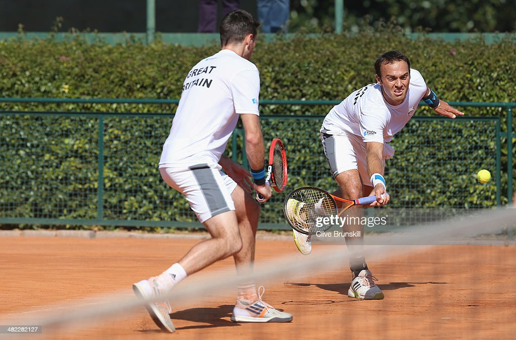 Doubles pairing of Colin Fleming and Ross Hutchins of Great Britain practice after the main draw ceremony prior to the Davis Cup World Group Quarter Final match between Italy and Great Britain at Tennis Club Napoli on April 3, 2014 in Naples, Italy.