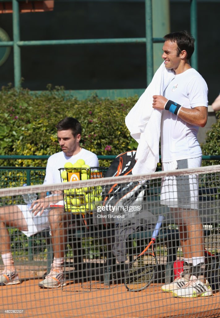 Doubles pairing of Colin Fleming and Ross Hutchins of Great Britain towell down during practice after the main draw ceremony prior to the Davis Cup World Group Quarter Final match between Italy and Great Britain at Tennis Club Napoli on April 3, 2014 in Naples, Italy.