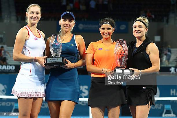 Doubles partners Ekaterina Makarova Elena Vesnina and hold the runner up trophy while Sania Mirza and Bethanie MattekSands of the USA hold the...