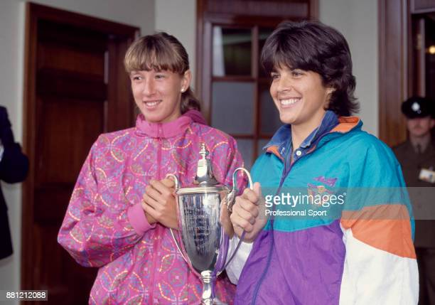 Doubles partners Gigi Fernandez of the USA and Natasha Zvereva of Belarus pose with the trophy after defeating Larisa Neiland of Latvia and Jana...