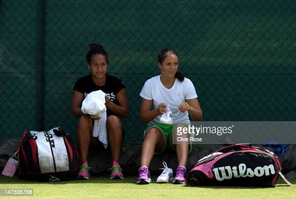 Doubles' partners Heather Watson and Laura Robson take a break during practice on day four of the Wimbledon Lawn Tennis Championships at the All...