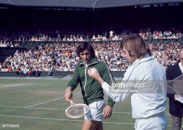 Doubles partners Ilie Nastase of Romania and Jimmy Connors of the USA walk on to the court during the Wimbledon Lawn Tennis Championships at the All...