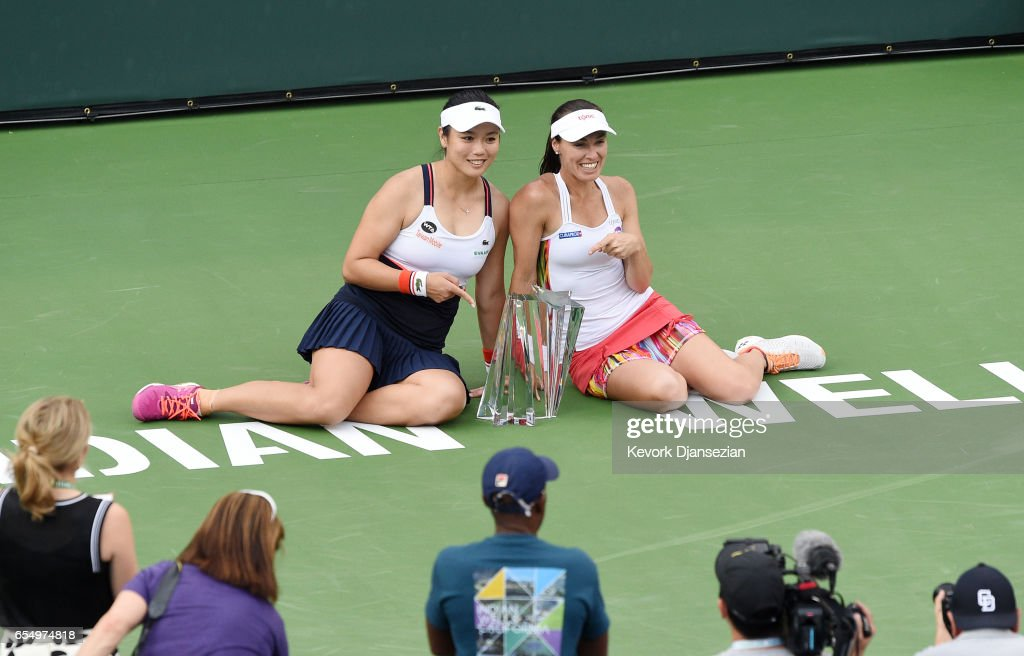 Doubles partners Yung-Jan Chan of Taiwan (L) and Martina Hingis of Switzerland poses with the doubles championship trophy after defeating Lucie Hradecka and Katerina Siniakova of Czech Republic at Indian Wells Tennis Garden on March 18, 2017 in Indian Wells, California.