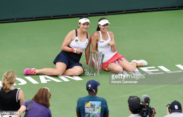 Doubles partners YungJan Chan of Taiwan and Martina Hingis of Switzerland poses with the doubles championship trophy after defeating Lucie Hradecka...