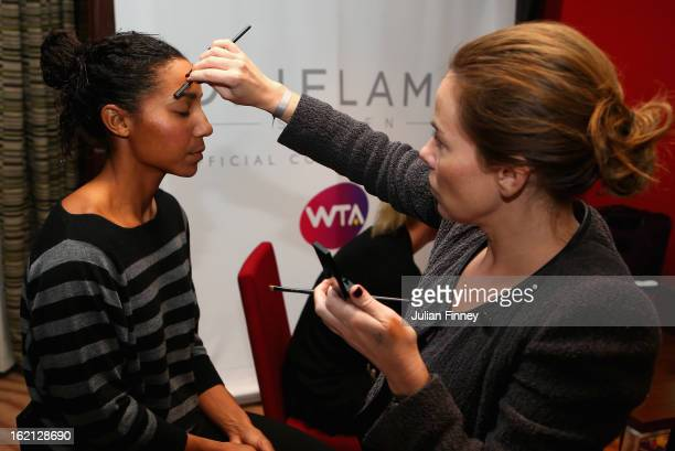 Doubles player Raquel KopsJones of USA are made up in the Oriflame suite before the players party during day two of the WTA Dubai Duty Free Tennis...