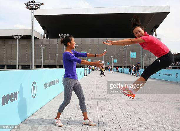 Doubles players Shuai Peng of China and SuWei Hsieh of Taipei pose for a photo dragon ball z meme during day six of the Mutua Madrid Open tennis...