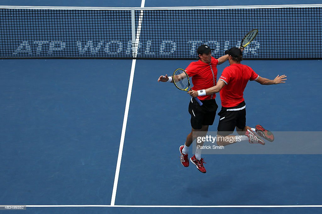 Doubles teammates <a gi-track='captionPersonalityLinkClicked' href=/galleries/search?phrase=Mike+Bryan&family=editorial&specificpeople=204456 ng-click='$event.stopPropagation()'>Mike Bryan</a> (L) and <a gi-track='captionPersonalityLinkClicked' href=/galleries/search?phrase=Bob+Bryan&family=editorial&specificpeople=203335 ng-click='$event.stopPropagation()'>Bob Bryan</a> celebrate after defeating Ivan Dodig of Croatia and Marcelo Melo of Brazil in the men's double final during the Citi Open at Rock Creek Park Tennis Center on August 9, 2015 in Washington, DC.