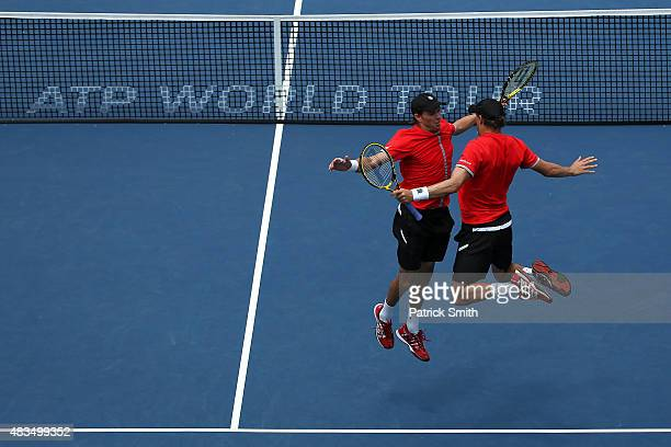 Doubles teammates Mike Bryan and Bob Bryan celebrate after defeating Ivan Dodig of Croatia and Marcelo Melo of Brazil in the men's double final...