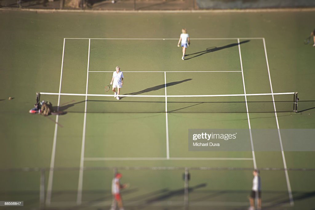 doubles tennis aerial view on public courts : Stock Photo