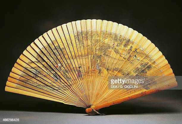 Doublesided fan with wooden slats decorated with a tea preparation scene hand painted 75x40 cm Japanese civilisation Edo period 17th18th century