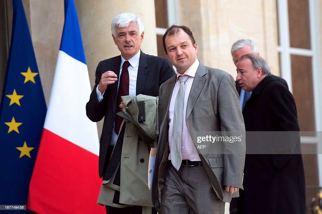 Doublet S.A. president Luc Doublet (L) and French home applicance manufacturer SEB's Chairman Thierry de La Tour d'Artaise arrive to share a working lunch with France's President Francois Hollande at the Elysee presidential palace in Paris on April 29, 2013.