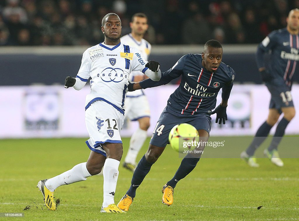 Doudou-Jacques Faty of SC Bastia and Blaise Matuidi of PSG in action during the French Ligue 1 match between Paris Saint Germain FC and Sporting Club de Bastia at the Parc des Princes stadium on February 8, 2013 in Paris, France.