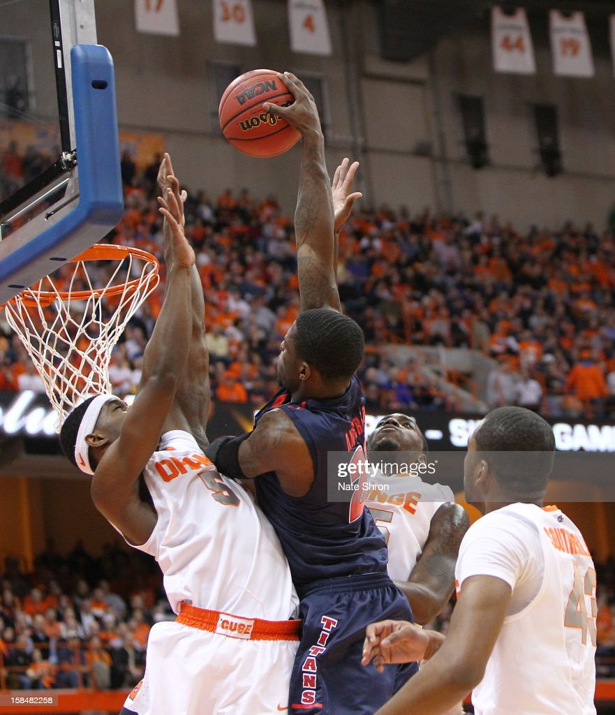 Doug Anderson #23 of the Detroit Titans dunks the ball against C.J. Fair #5, Rakeem Christmas #25 and James Southerland #43 of the Syracuse Orange during the game at the Carrier Dome on December 17, 2012 in Syracuse, New York.