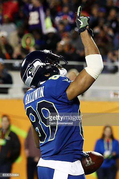 Doug Baldwin of the NFC celebrates a touchdown in the second quarter against the AFC during the NFL Pro Bowl at the Orlando Citrus Bowl on January 29...