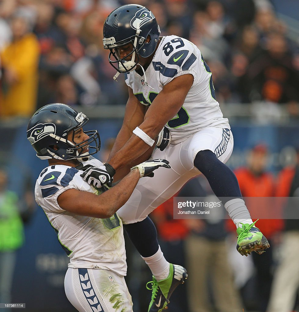 Doug Baldwin #89 of the Seattle Seahawks celebrates with Golden Tate #81 after Tate caught the go-ahead touchdown pass in the 4th quarter against the Chicago Bears at Soldier Field on December 2, 2012 in Chicago, Illinois. The Seahawks defeated the Bears 23-17 in overtime.