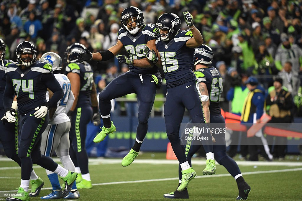 Doug Baldwin #89 of the Seattle Seahawks celebrates with Jermaine Kearse #15 after scoring a 13-yard touchdown during the fourth quarter against the Detroit Lions in the NFC Wild Card game at CenturyLink Field on January 7, 2017 in Seattle, Washington.