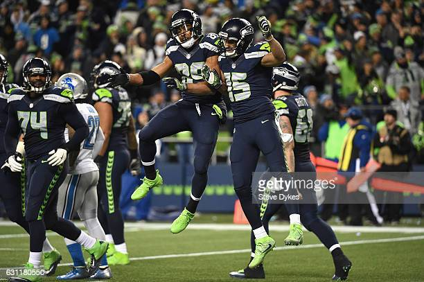 Doug Baldwin of the Seattle Seahawks celebrates with Jermaine Kearse after scoring a 13yard touchdown during the fourth quarter against the Detroit...