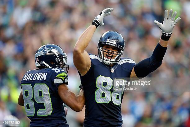 Doug Baldwin of the Seattle Seahawks celebrates with Jimmy Graham of the Seattle Seahawks after scoring a touchdown during the second quarter of a...