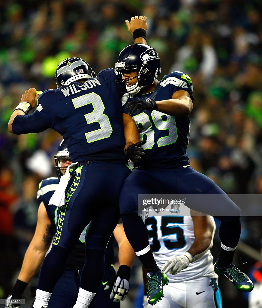 Doug Baldwin #89 of the Seattle Seahawks celebrates with Russell Wilson #3 after catching a 16 yard touchdown pass in the first quarter against the Carolina Panthers during the 2015 NFC Divisional Playoff game at CenturyLink Field on January 10, 2015 in Seattle, Washington.