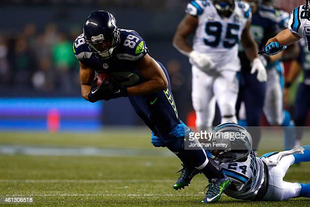 Doug Baldwin of the Seattle Seahawks gets tackled by Josh Norman of the Carolina Panthers during the 2015 NFC Divisional Playoff game at CenturyLink...