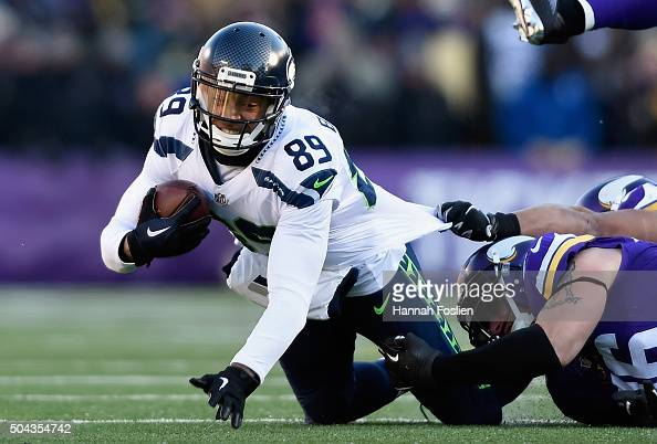 Doug Baldwin of the Seattle Seahawks is tackled in the second quarter against the Minnesota Vikings during the NFC Wild Card Playoff game at TCFBank...