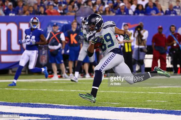 Doug Baldwin of the Seattle Seahawks runs 22yards for a touchdown against the New York Giants during the third quarter of the game at MetLife Stadium...
