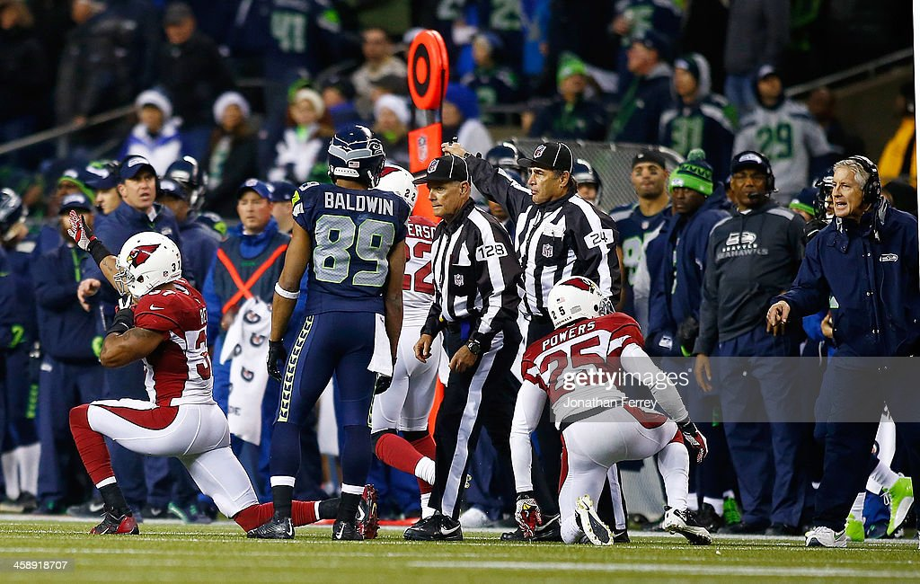 <a gi-track='captionPersonalityLinkClicked' href=/galleries/search?phrase=Doug+Baldwin+-+American+Football+Player&family=editorial&specificpeople=4542613 ng-click='$event.stopPropagation()'>Doug Baldwin</a> #89 of the Seattle Seahawks talks to the referee after an interception by Carlos Dansby (not pictured) of the Arizona Cardinals as <a gi-track='captionPersonalityLinkClicked' href=/galleries/search?phrase=Yeremiah+Bell&family=editorial&specificpeople=965227 ng-click='$event.stopPropagation()'>Yeremiah Bell</a> #37 celebrates on December 22, 2013 at CenturyLink Field in Seattle, Washington.