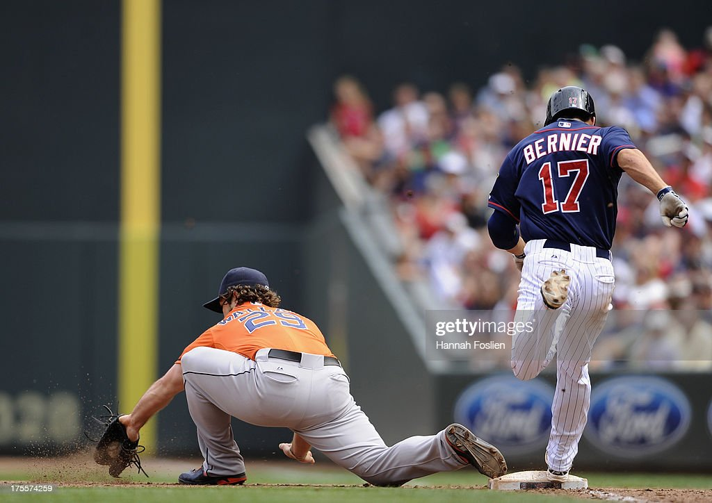 Doug Bernier #17 of the Minnesota Twins is out at first base as <a gi-track='captionPersonalityLinkClicked' href=/galleries/search?phrase=Brett+Wallace&family=editorial&specificpeople=2364861 ng-click='$event.stopPropagation()'>Brett Wallace</a> #29 of the Houston Astros fields the ball during the fifth inning of the game on August 4, 2013 at Target Field in Minneapolis, Minnesota.
