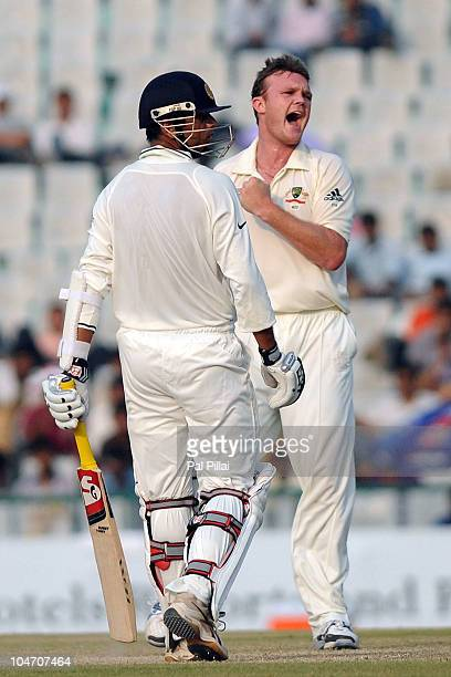 Doug Bollinger of Australia celebrates the wicket of Rahul Dravid of India during day four of the First Test match between India and Australia at...