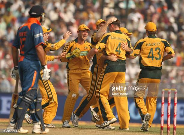 Doug Bollinger of Australia celebrates with his team mates after taking the wicket of Sachin Tendulkar of India during the sixth One Day...