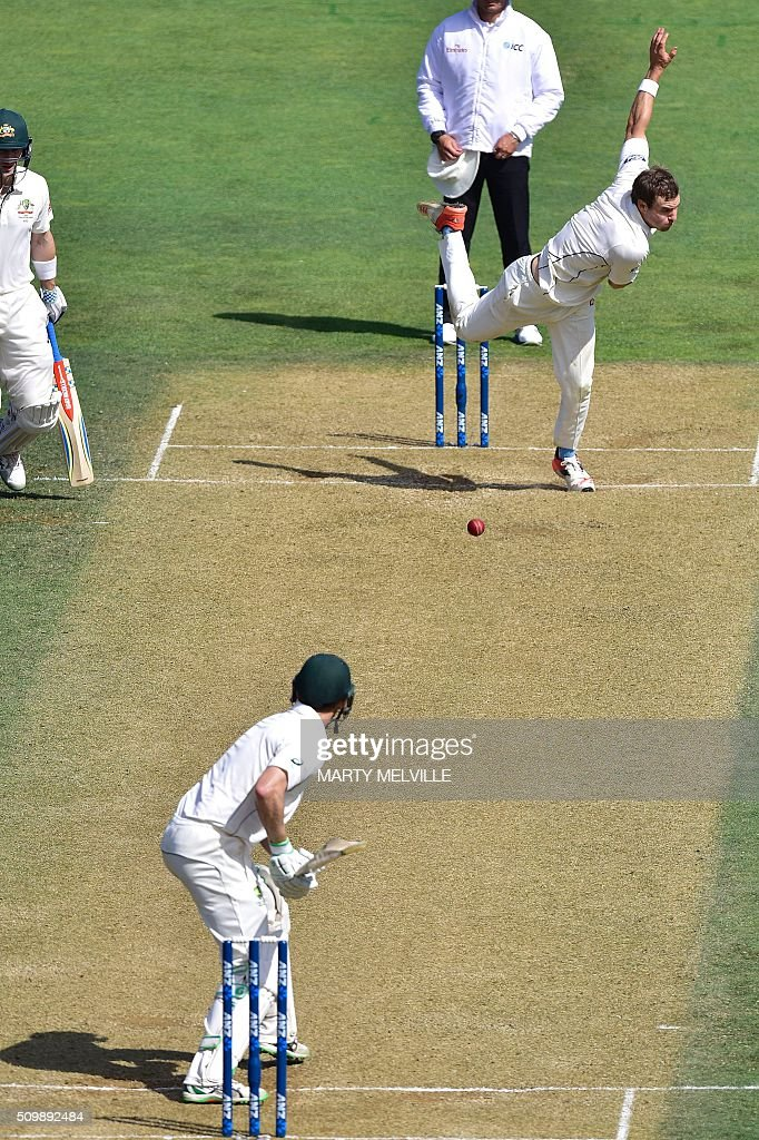Doug Bracewell of New Zealand (Top) bowls to Adam Voges (Bottom) of Australia during day two of the first cricket Test match between New Zealand and Australia at the Basin Reserve in Wellington on February 13, 2016. AFP PHOTO / MARTY MELVILLE / AFP / Marty Melville
