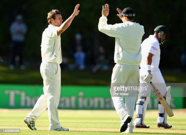 Doug Bracewell of New Zealand celebrates his wicket of Jacques Rudolph of South Africa with Tim Southee during day two of the First Test match...
