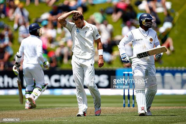 Doug Bracewell of New Zealand holds his head during day two of the Second Test match between New Zealand and Sri Lanka at Basin Reserve on January 4...