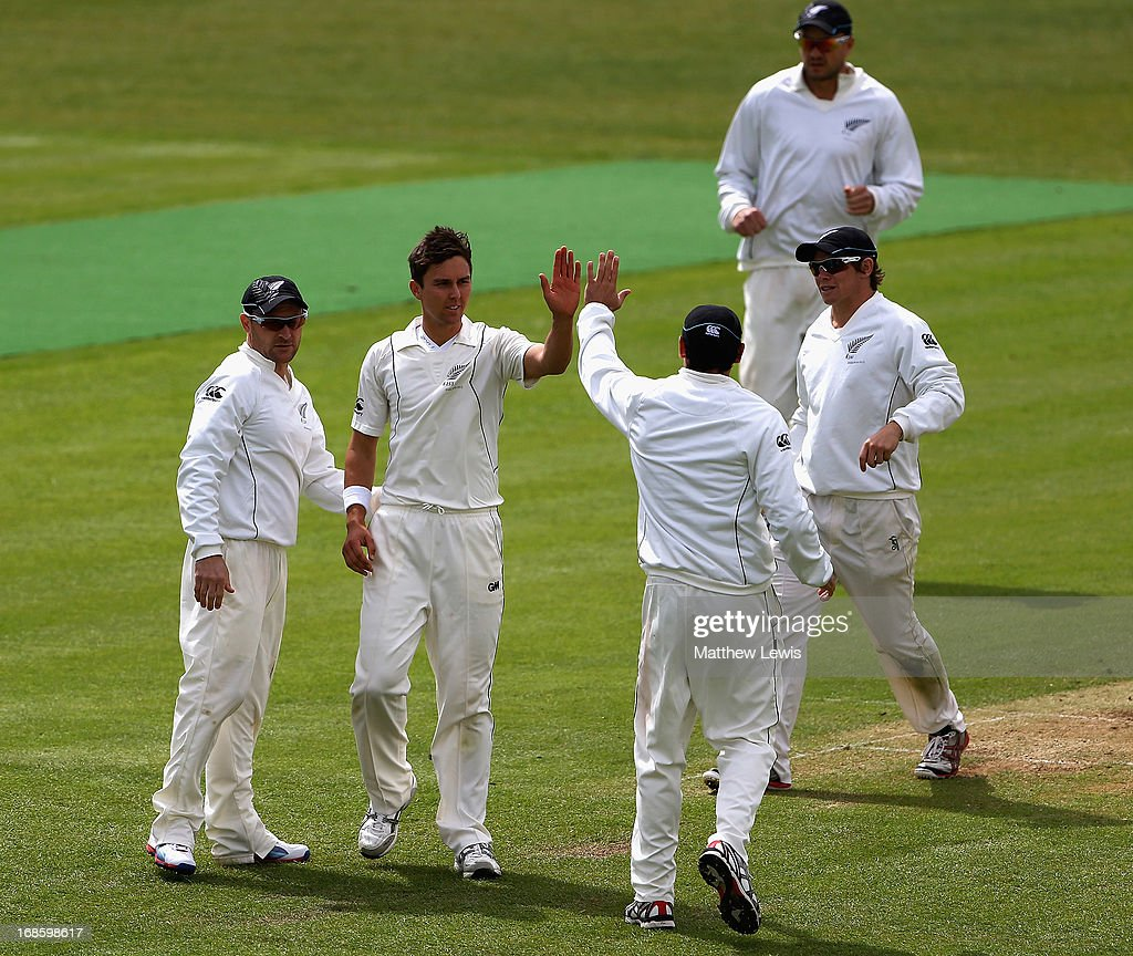<a gi-track='captionPersonalityLinkClicked' href=/galleries/search?phrase=Doug+Bracewell&family=editorial&specificpeople=6680321 ng-click='$event.stopPropagation()'>Doug Bracewell</a> of New Zealand is congratulated on bowling Joe Root of England Lions during day four of the tour match between England Lions and New Zealand at Grace Road on May 12, 2013 in Leicester, England.