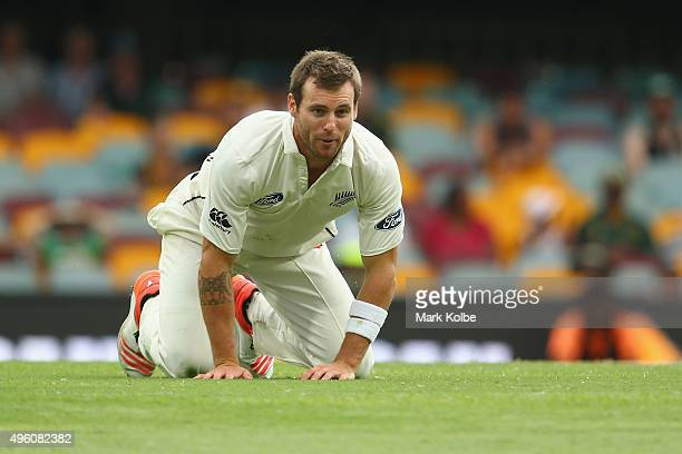Doug Bracewell of New Zealand looks up after falling while bowling during day three of the First Test match between Australia and New Zealand at The...