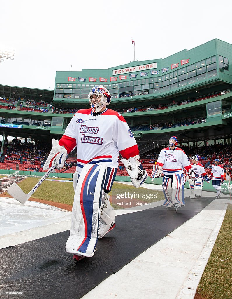 Doug Carr #31 of the Massachusetts Lowell River Hawks leads his teammate Connor Hellebuyck #37 and the rest of his team to the ice before NCAA hockey action against the Northeastern University Huskies in the 'Citi Frozen Fenway 2014' at Fenway Park on January 11, 2014 in Boston, Massachusetts.