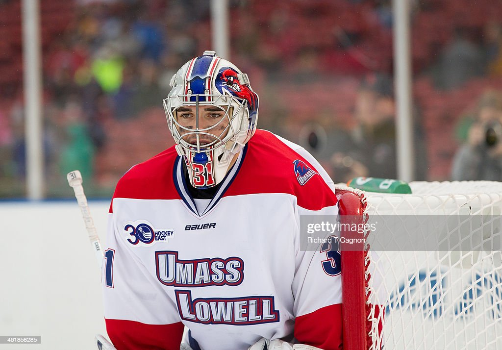 Doug Carr #31 of the Massachusetts Lowell River Hawks looks for the puck against the Northeastern University Huskies during NCAA hockey action in the 'Citi Frozen Fenway 2014' at Fenway Park on January 11, 2014 in Boston, Massachusetts.