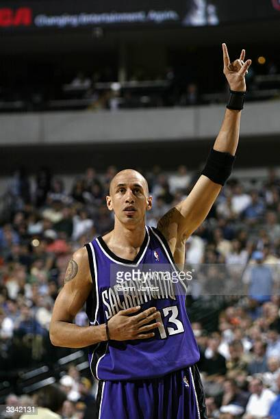 Doug Christie of the Sacramento Kings celebrates during the game against the Dallas Mavericks at American Airlines Arena on April 1 2004 in Dallas...