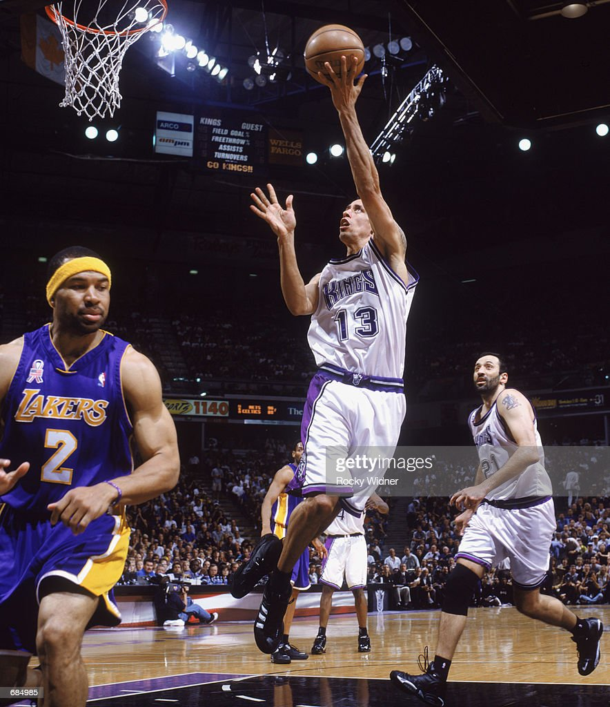 Doug Christie of the Sacramento Kings shoots the ball during game 7 of the Western Conference Finals during the 2002 NBA Playoffs against the Los...