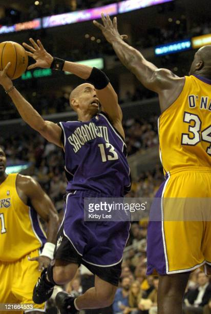 Doug Christie of the Sacramento Kings takes a shot during the game between the Sacramento Kings and the Los Angeles Lakers at the Staples Center in...