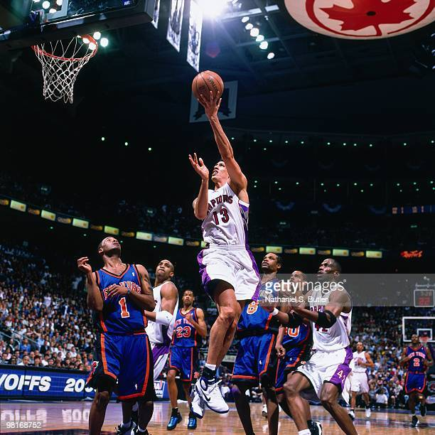 Doug Christie of the Toronto Raptors shoots a layup against Chris Childs of the New York Knicks during Game Three of the 2000 Eastern Conference...