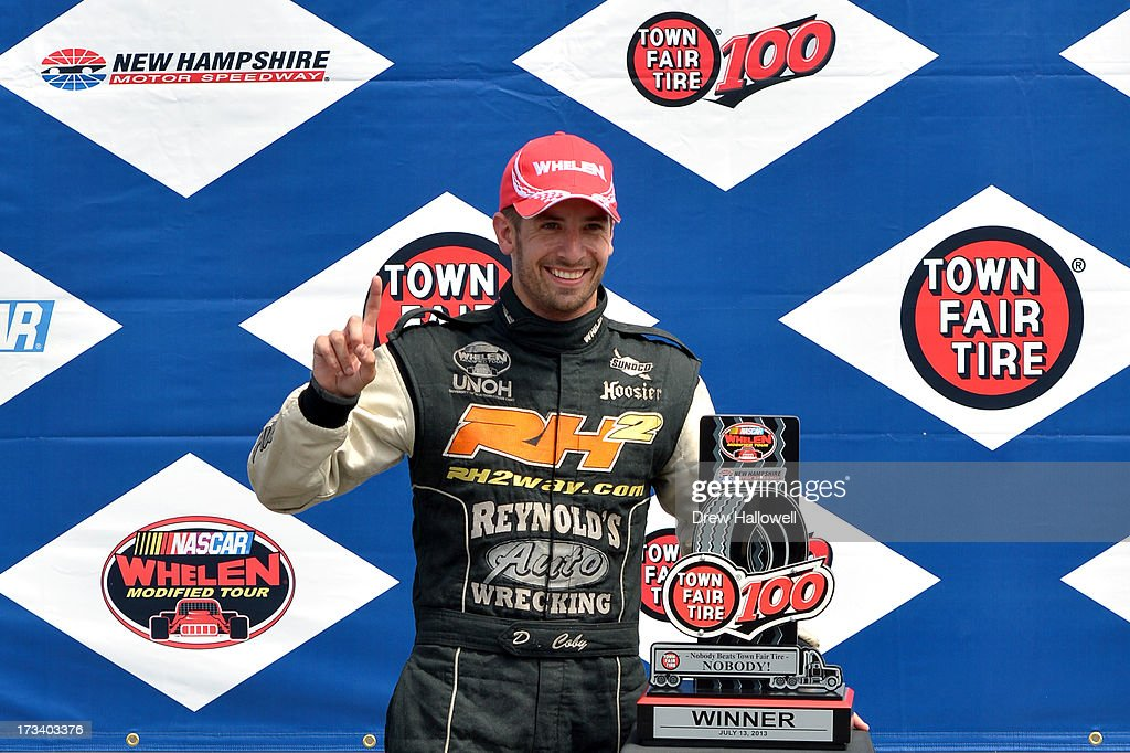 Doug Coby, driver of the #52 Furnace & Duct/Seekonk Grand Prix Chevrolet, celebrates in Victory Lane after winning the NASCAR Whelen Modified Tour Town Fair Tire 100 at New Hampshire Motor Speedway on July 13, 2013 in Loudon, New Hampshire.
