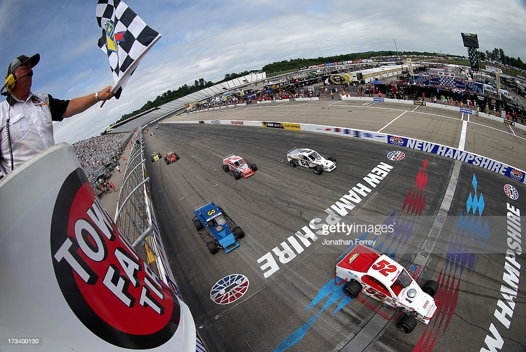 Doug Coby, driver of the #52 Furnace & Duct/Seekonk Grand Prix Chevrolet, crosses the finish line to win to win the NASCAR Whelen Modified Tour Town Fair Tire 100 at New Hampshire Motor Speedway on July 13, 2013 in Loudon, New Hampshire.