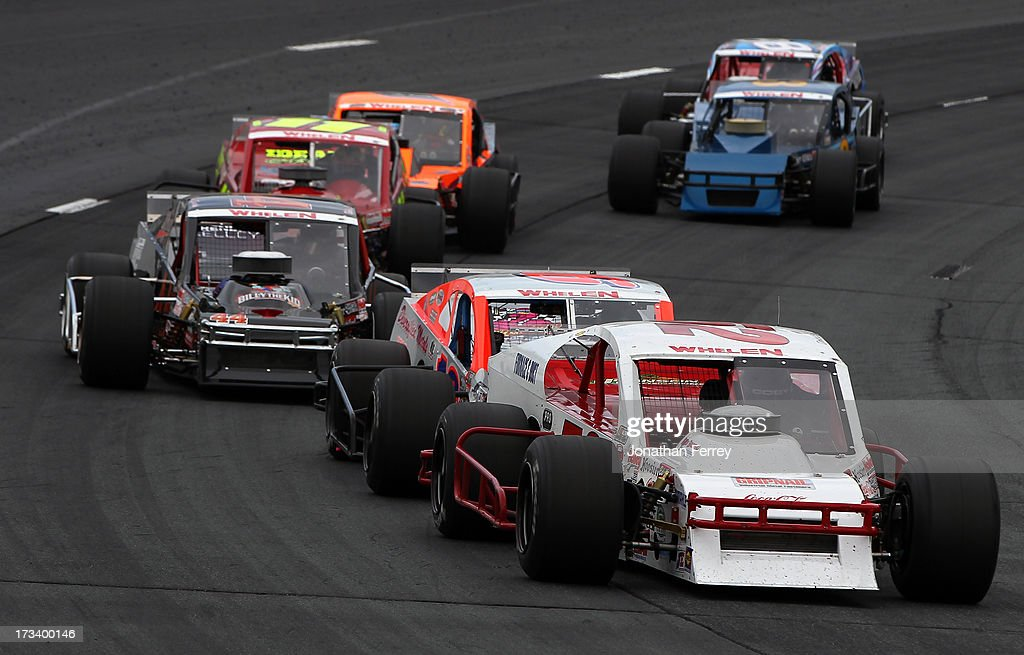 Doug Coby, driver of the #52 Furnace & Duct/Seekonk Grand Prix Chevrolet, leads the field during the NASCAR Whelen Modified Tour Town Fair Tire 100 at New Hampshire Motor Speedway on July 13, 2013 in Loudon, New Hampshire.