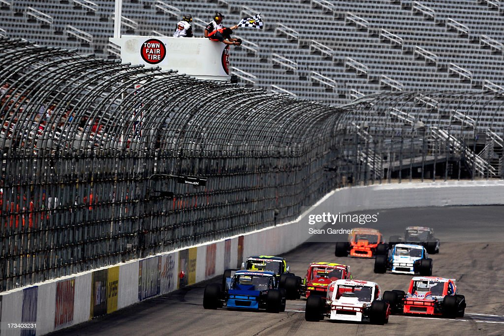 Doug Coby, driver of the #52 Furnace & Duct/Seekonk Grand Prix Chevrolet, crosses the finish line to win the NASCAR Whelen Modified Tour Town Fair Tire 100 at New Hampshire Motor Speedway on July 13, 2013 in Loudon, New Hampshire.
