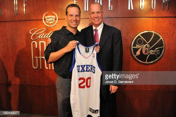 Doug Collins poses for a photo with his son Chris Collins after being named the new coach of the Philadelphia 76ers during the press conference on...