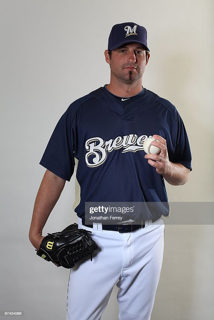 <a gi-track='captionPersonalityLinkClicked' href=/galleries/search?phrase=Doug+Davis&family=editorial&specificpeople=211598 ng-click='$event.stopPropagation()'>Doug Davis</a> #25 poses for a portrait during the Milwaukee Brewers Photo Day at the Maryvale Baseball Park on March 1, 2010 in Maryvale, Arizona.