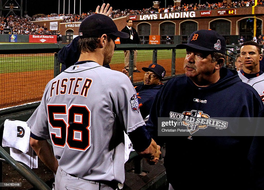 Doug Fister #58 of the Detroit Tigers is greeted by pitching coach Jeff Jones in the dugout after Fister was taken out of the game in the seventh inning against the San Francisco Giants during Game Two of the Major League Baseball World Series at AT&T Park on October 25, 2012 in San Francisco, California.